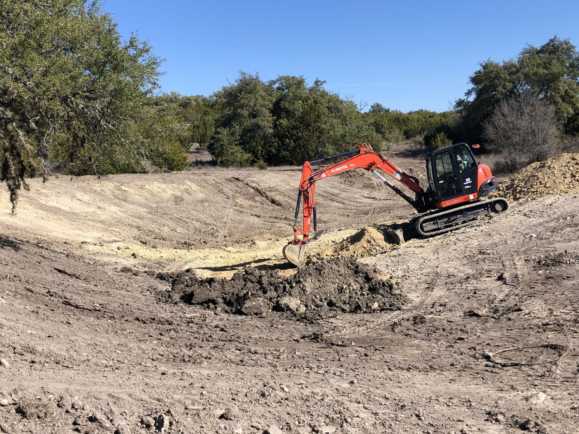 machinery preparing then pond for pond sealing application