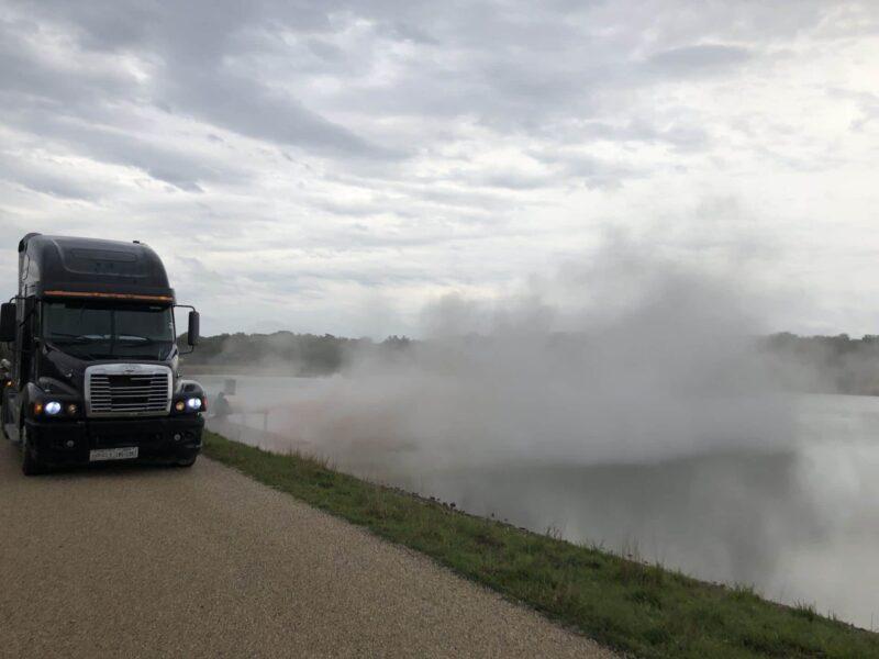 Truck Sprinkling Bentonite - Fix a leaking pond