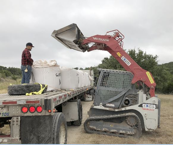 Loading a truck with Bentonite Pond Sealant