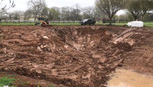 pond reshaping project in Texas